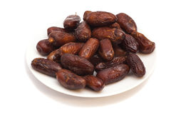 Fresh dates on white plate Royalty Free Stock Photography