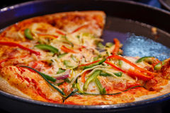 Fresh Deep Dish Pizza with Peppers Royalty Free Stock Image