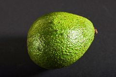 Fresh delicious avocado isolated on a black background Royalty Free Stock Image