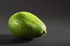 Fresh delicious avocado isolated on a black background Royalty Free Stock Photo