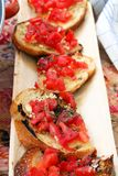 Bruschettas on a wooden plate Royalty Free Stock Photography