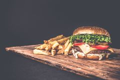 Delicious burger on wood stock image