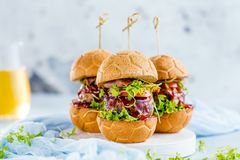 Fresh delicious burgers in Form of Football soccer royalty free stock photo