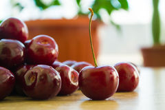 Fresh delicious cherries on the table. Summer harvest. Useful fruit stock photos