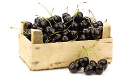 Fresh delicious cherries in a wooden box Royalty Free Stock Photos