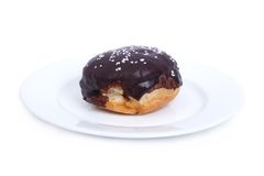 Fresh delicious chocolate donut isolated on a white. Plate royalty free stock photography