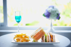 Fresh and delicious classic club sandwich with french fries Royalty Free Stock Photography