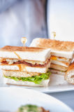 Fresh and delicious classic club sandwich on white dish Stock Images