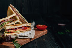 Fresh delicious club sandwich on the wooden dark table with copy space Royalty Free Stock Photography
