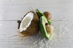 Fresh, delicious coconut with avocado on a wooden white background Stock Images
