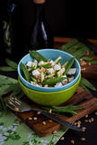 Fresh delicious cucumber, green peas, feta and pine nuts salad Stock Photos