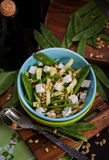 Fresh delicious cucumber, green peas, feta and pine nuts salad Royalty Free Stock Photo