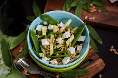 Fresh delicious cucumber, green peas, feta and pine nuts salad Stock Photography