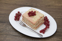 Fresh delicious diet cake with berry red currant at Dukan Diet on a porcelain plate with a spoon on a wooden background. Royalty Free Stock Photography