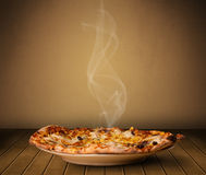 Fresh delicious home cooked pizza with steam. On wood deck royalty free illustration