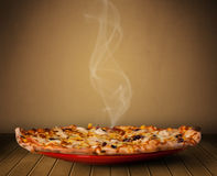 Fresh delicious home cooked pizza with steam Royalty Free Stock Photo
