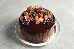 Fresh delicious homemade chocolate cake. With berries on gray table royalty free stock photos
