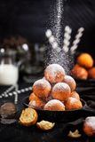 Fresh delicious homemade cottage cheese ball donuts with powdered sugar on dark background royalty free stock photo