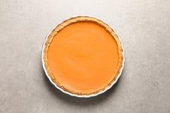 Fresh delicious homemade pumpkin pie on gray background stock photos