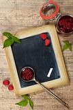 Fresh and  Delicious Homemade Raspberries Jam. Healthy Eating Concept with Fresh Raspberries on a Chalkboard. Selective focus Royalty Free Stock Photography
