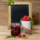 Fresh and  Delicious Homemade Raspberries Jam. Healthy Eating Concept with Fresh Raspberries on a Chalkboard. Selective focus Stock Photo