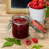 Fresh and  Delicious Homemade Raspberries Jam. Healthy Eating Concept with Fresh Raspberries with Chalkboard. Selective focus Stock Photos