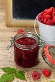 Fresh and  Delicious Homemade Raspberries Jam. Healthy Eating Concept with Fresh Raspberries with Chalkboard. Selective focus Royalty Free Stock Photography