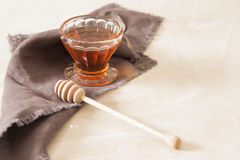 Fresh delicious honey in a crystal glass. On a light background stock photos