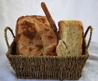 Fresh homemade bread only from the oven and immediately on the table. Fresh, delicious hot homemade bread baking in the oven and immediately serving on the table stock photography