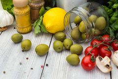 Fresh delicious ingredients for healthy cooking or salad making. On wooden background. Diet or vegetarian food concept Royalty Free Stock Images