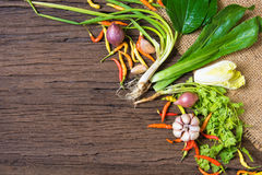 Fresh delicious ingredients. For healthy cooking or salad making on rustic background, top view Stock Photo