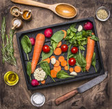 Fresh delicious ingredients for healthy cooking or salad making on rustic background, top view Diet or vegetarian food concept Royalty Free Stock Images