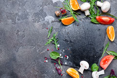 Fresh delicious ingredients for healthy cooking salad. Fresh delicious ingredients for healthy cooking or salad making on stone background, top vie copy space Stock Photography