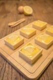 Fresh delicious lemon tart dessert on wooden cutting board Stock Photography
