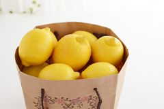 Fresh lemons. Fresh and delicious lemons in the paper bagn Royalty Free Stock Image