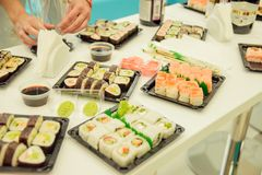 Fresh and delicious maki and nigiri sushi and sake glass. Royalty Free Stock Image