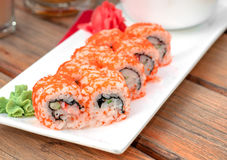 Fresh delicious maki and nigiri sushi sake glass Stock Images