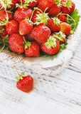 Fresh and delicious organic strawberries on old metal plate, wooden table. Perfect for your healthy eating dieting. Royalty Free Stock Photography