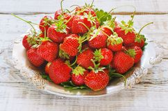 Fresh and delicious organic strawberries on old metal plate,  wooden table. Perfect for your healthy eating  dieting. Stock Photos