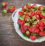 Fresh and delicious organic strawberries on old metal plate, wooden table. Perfect for your healthy eating dieting. Royalty Free Stock Photo