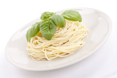 Fresh delicious pasta with basil isolated on white royalty free stock photo