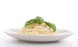 Fresh delicious pasta with basil isolated on white Stock Photo