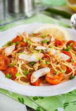 Fresh delicious pasta with fish and tomato sauce Stock Photo