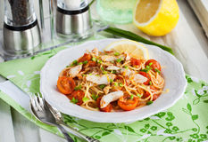 Fresh delicious pasta with fish and tomato sauce Royalty Free Stock Photography