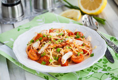 Fresh delicious pasta with fish and tomato sauce Royalty Free Stock Image