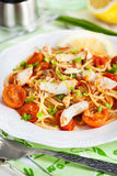 Fresh delicious pasta with fish and tomato sauce Royalty Free Stock Images