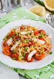 Fresh delicious pasta with fish and tomato sauce Stock Images