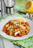 Fresh delicious pasta with fish and tomato sauce Royalty Free Stock Photo