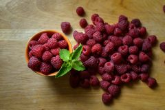 Fresh Delicious Raspberries on a wooden board v4 stock photography
