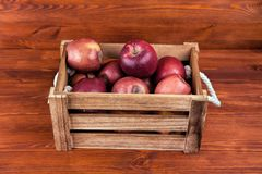 Fresh and delicious red  apples in a wooden crate on a white bac. Kground Royalty Free Stock Photography